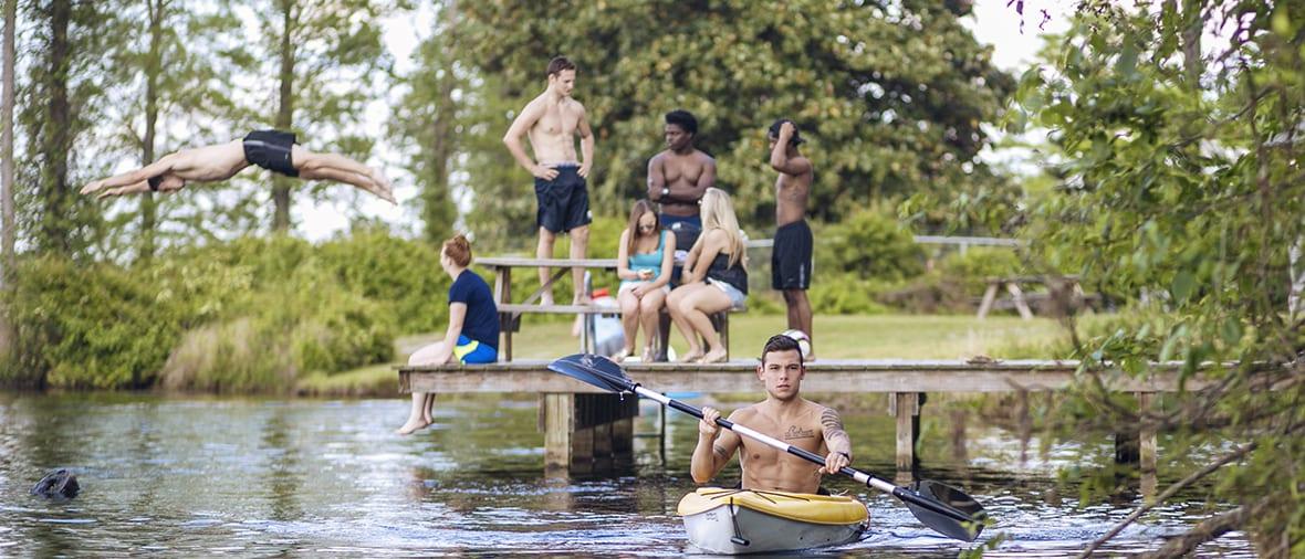 students enjoying the lake