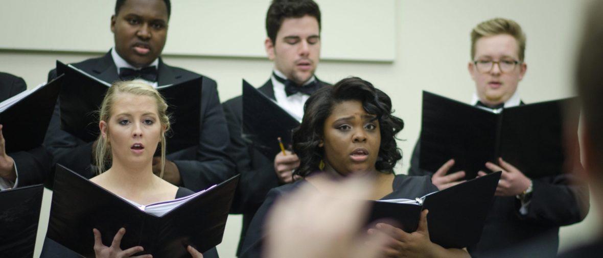 Students at choir rehearsal