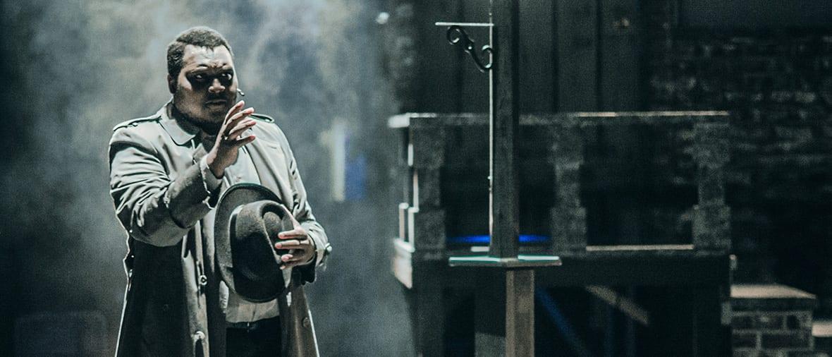 A student portrays Sweeney Todd, the Demon Barber of Fleet Street amid a foggy, moody set